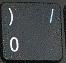 символ «/» при включенном режиме NumLock.